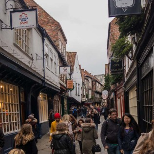 The most famous street in York, the Shambles, dating from the 14th century with its overhanging timber-framed buildings.