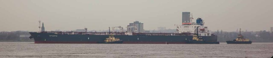 Large cargo vessels can be seen.