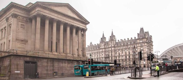 Side of St George's Hall with Lime Street Station beyond.