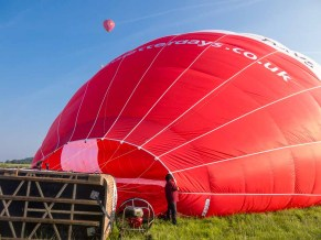 Giant petrol engine driven fan inflating the balloon.